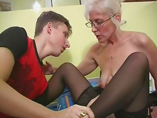 Old with Silver Hair Glasses and Nylons Wakes the Chap