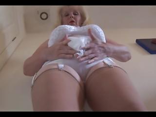 Older big breasted lady in sheer slide undresses