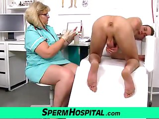Slim chap receives a tugjob from obese milf doctor Anna