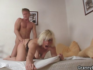 Older blond takes it doggy style