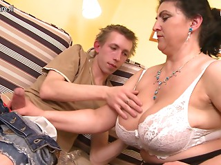 Nice-looking mom drilled hard by youthful lad and squirts