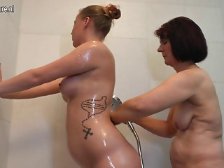 Hirsute grandmother copulates youthful lesbian hotty
