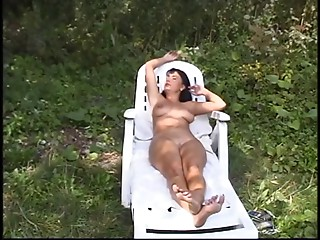 Hot elder honey strokes and sucks 2 dicks at one time