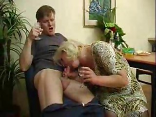Russian Auntie And Chap Have A Swallow