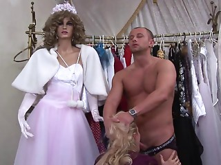Hungry hooker sucks customer's jock in a garments shop