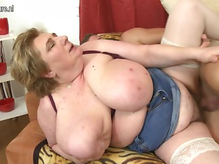 Massive breasted BBW mamma getting drilled by her toy guy
