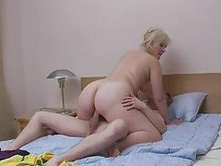 Old woman and juvenile stud having joy