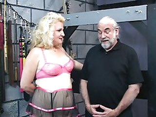Busty, older blonde acquires her a-hole whipped in the dungeon