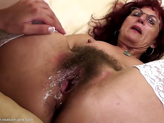 Unshaved mama acquires unfathomable fisting from youthful beauty