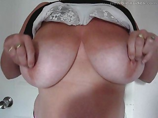 Big breasted Cougar shows off the twins