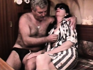 Vintage French sex movie scene with a older curly pair