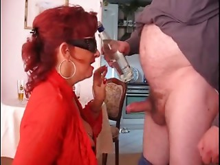 Old hooker drinking and engulfing cock!