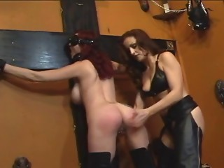 Cute redhead acquires dominated by redhead in dark leather