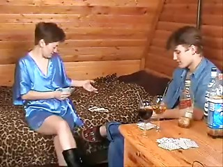 Russian mother and guy playing strip-poker