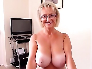 Aged large natural breast fellatio POV