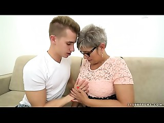 Grandma deepthroats a youthful large cock in advance of riding on it