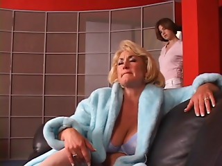 Sexy old golden-haired acquires her zeppelins grabbed by sexy youthful brunette hair