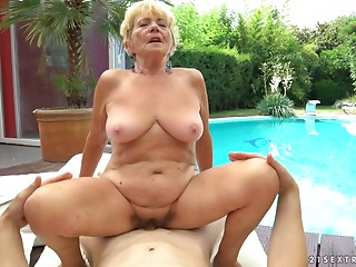 Old bitch copulates next to a pool