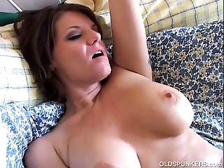 Nice-looking big breasted older spunker can't live without to play with her wet slit