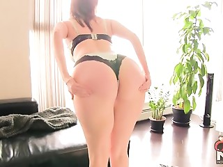 large wazoo redhead with hawt curves undresses and teases